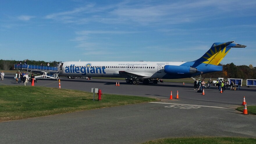 Passengers leave an Allegiant Air jet at Concord Regional Airport.
