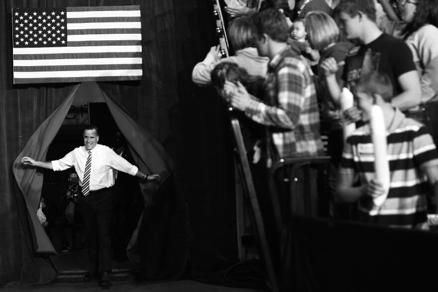 Republican Presidential candidate Mitt Romney arrives for a rally in Des Moines, Iowa, on Sunday.