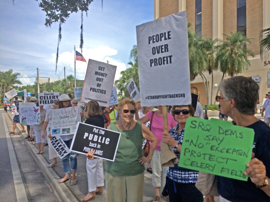 Sarasota residents protest a concrete recycling plant at a planning commission meeting Thursday.