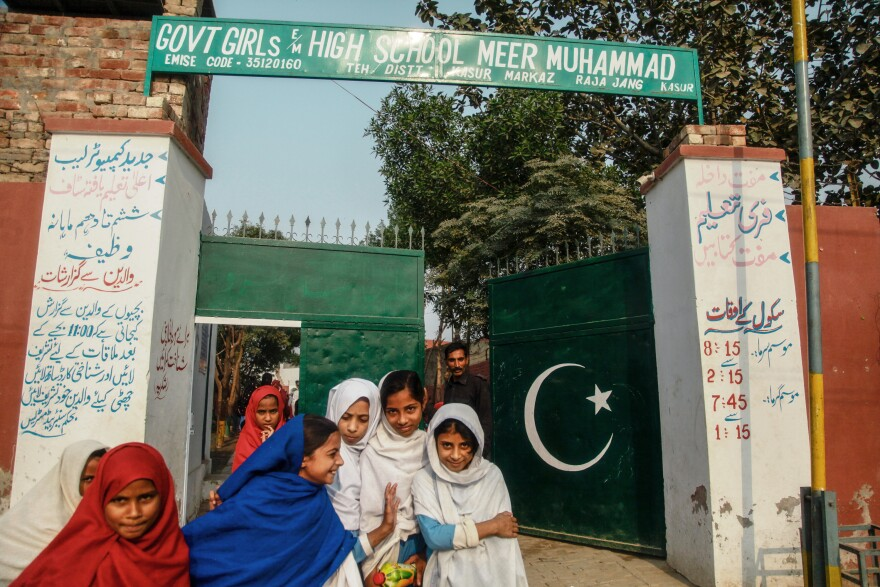 Students exit the Government Girls High School of Meer Muhammad.