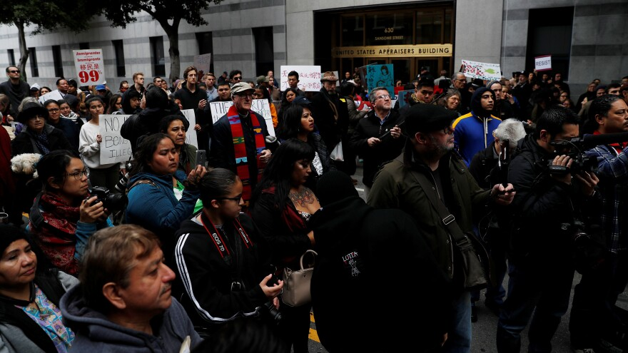 A spokesman for Immigration and Customs Enforcement in San Francisco has resigned, citing disagreements over how to cast the actions of Oakland Mayor Libby Schaaf, who warned against immigration raids last month. The raids prompted a rally outside the ICE office in San Francisco.