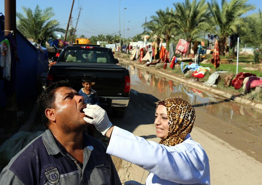 An Iraqi man receives a dose of cholera vaccine in Baghdad on Nov. 1. There have been more than 1,800 cases in the country.
