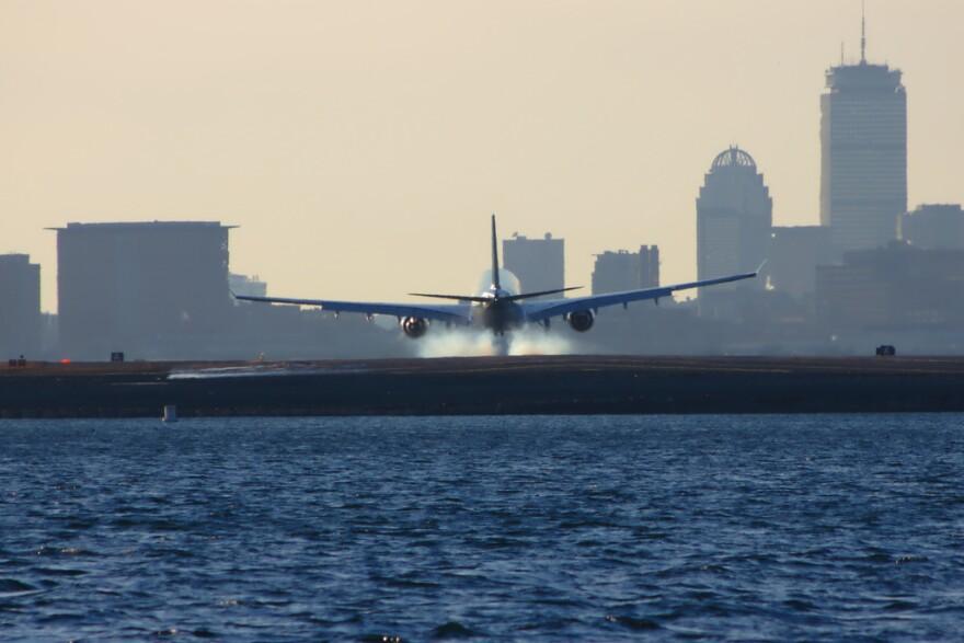 Plane touching down at Logan Airport