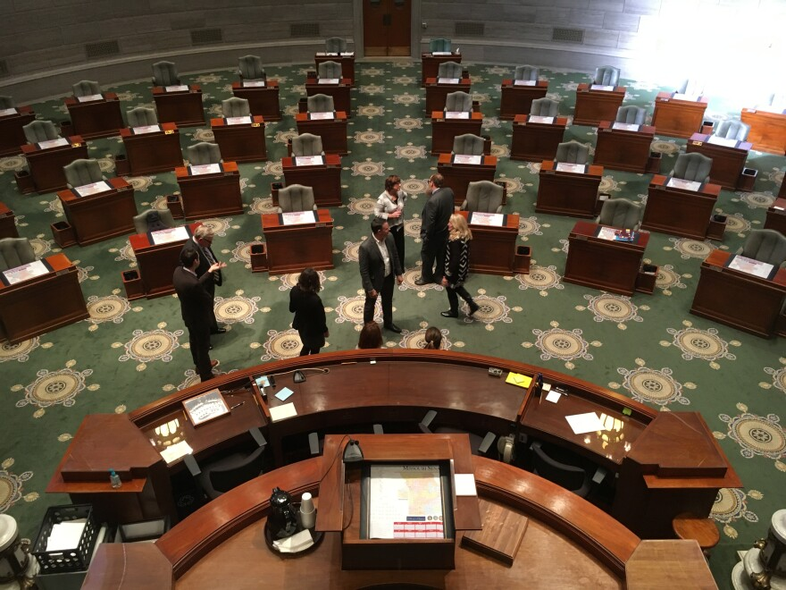 Senators mingle in the Senate chamber last week in Jefferson City.