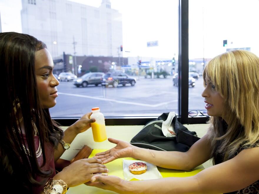 Alexandra (Taylor) and Sin-Dee (Kitana Kiki Rodriguez) take a break on Christmas Eve in <em>Tangerine</em>.