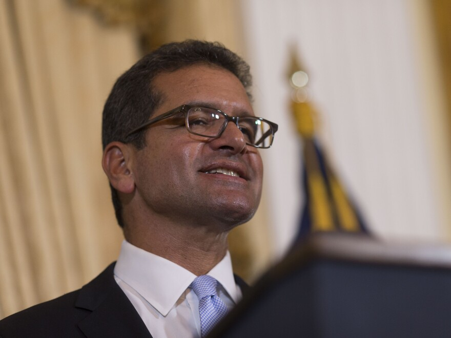 Pedro Pierluisi, sworn in as Puerto Rico's new governor, speaks during a press conference, in San Juan, Puerto Rico, on Friday.