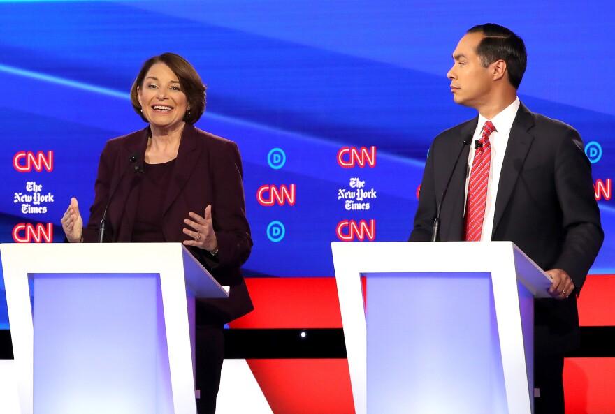 Minnesota Sen. Amy Klobuchar speaks as former Secretary of Housing and Urban Development Julián Castro looks on during the debate.