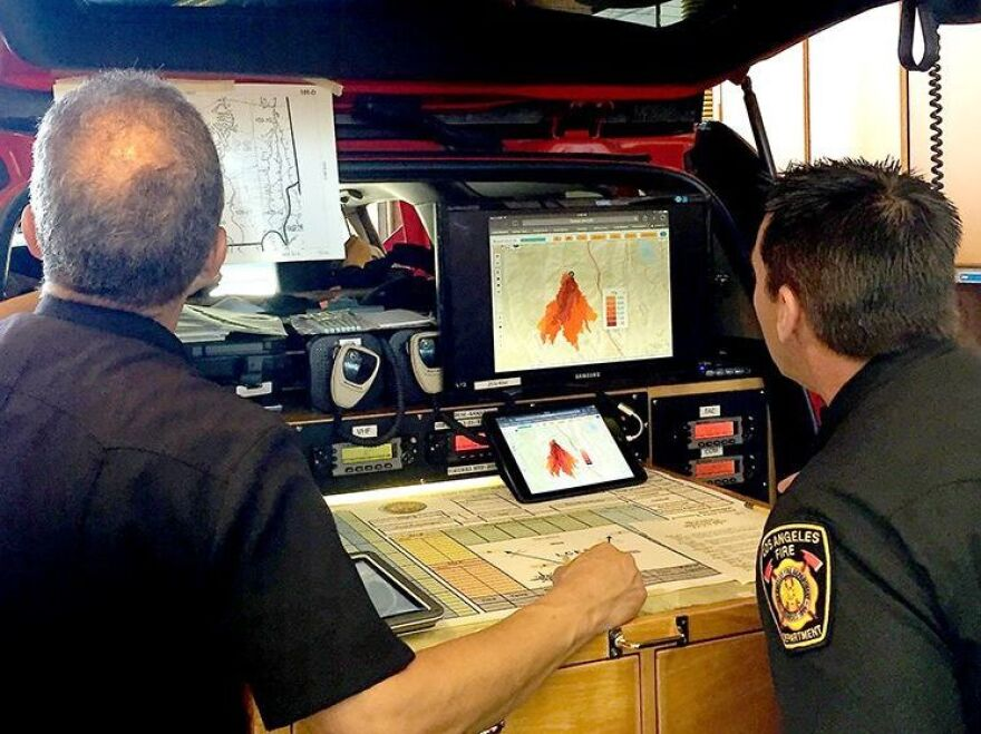 Los Angeles Fire Department staff look at a new fire prediction tool, powered by supercomputers.