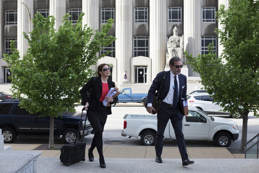 Michelle Nasser and Scott Rosenblum, members of Missouri Gov. Eric Greitens' defense team, arrive at the St. Louis Civil Courts building Thursday morning for the first day of jury selection in Greitens' felony invasion of privacy trial. 051018
