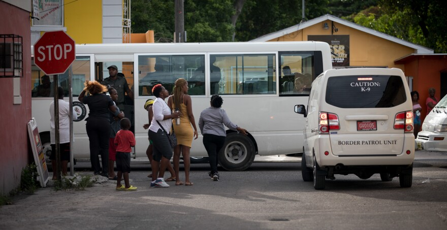 The border patrol rounds up undocumented Haitian immigrants in Nassau on Sept. 30. Two days later, Prime Minister Hubert Minnis announced that Haitians in the Bahamas without documentation would be deported.