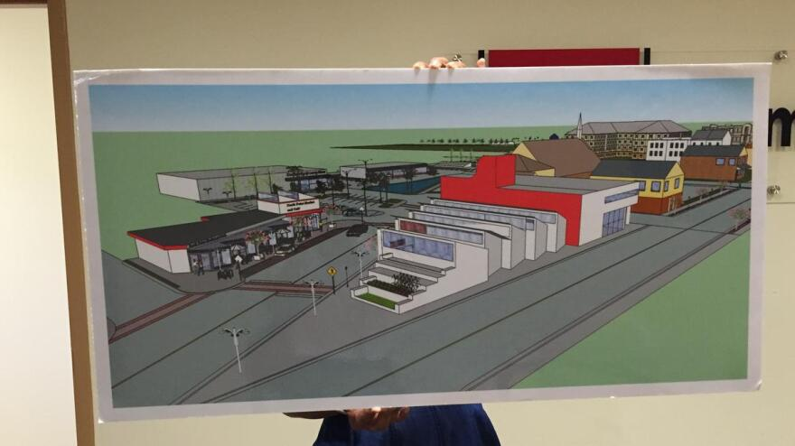 Northwest Jacksonville CDC COO Dara Davis holds up a rendering of plans for Phase 2 of the commercial development project at Moncrief and Myrtle in 2016.