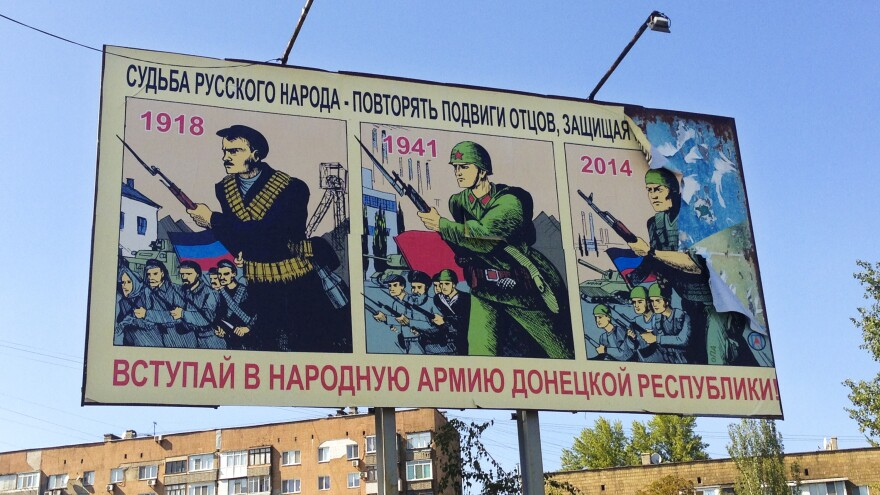 "A recruitment poster in Donetsk reads ""the fate of the Russian people is at stake — repeat the heroic deeds of your fathers and grandfathers. Sign up for the Donetsk People's Republic Army."""