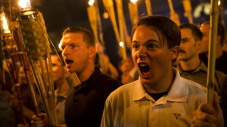 Peter Cvjetanovic (right) chants while holding torches at a march organized by neo-Nazi, white supremacist and white nationalist organizations in Charlottesville, Va., on Friday night.