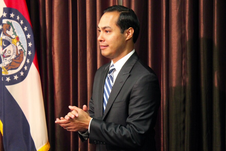 HUD Secretary Julian Castro readies himself to announce $26 million in federal funds to St. Louis County.