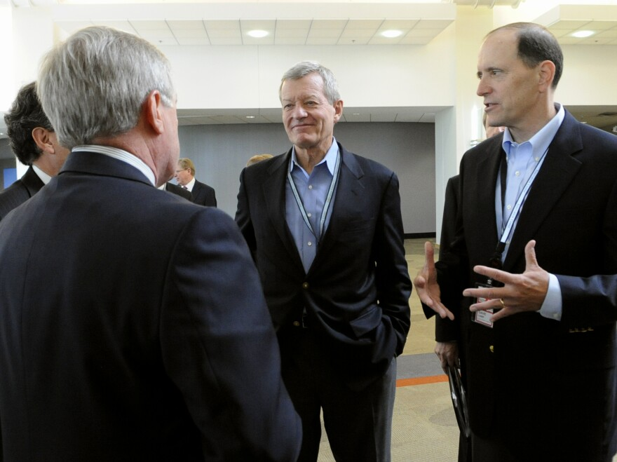 Senate Finance Committee Chairman Sen. Max Baucus, D-Mont., (center) and House Ways and Means Committee Chairman Rep. Dave Camp, R-Mich., (right) speak about overhauling the tax code at the 3M Innovation Center in Maplewood, Minn., on July 8.