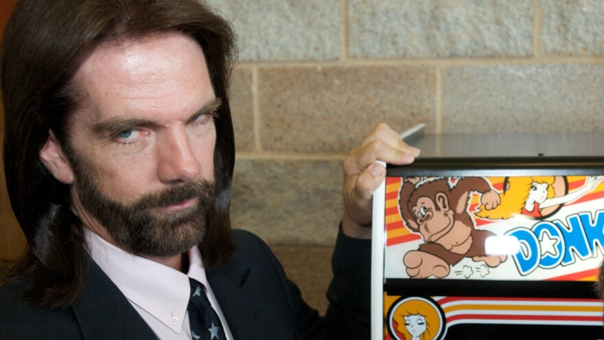 "Billy Mitchell, described once as ""Video Game Player of the Century,"" poses for a portrait in front of Donkey Kong in Ottumwa, Iowa, in 2009."