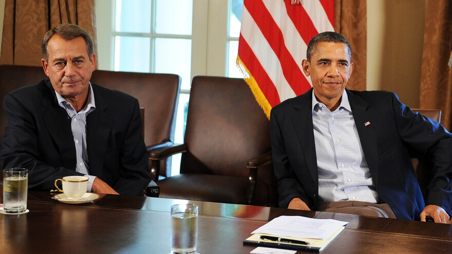 President Obama and House Speaker John Boehner meet in the White House on July 23, 2011. At that time, they were discussing how to avert a debt default. The talks ultimately led to the deal that now brings us aspects of the so-called fiscal cliff.