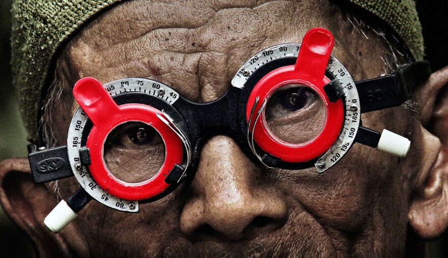 An optometrist confronts the killers responsible for his brother's death during the 1965 Indonesian genocide in <em>The Look of Silence</em>.