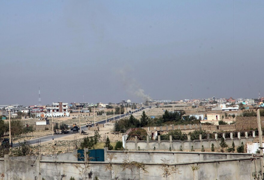 Smoke rises from Kunduz, Afghanistan on Thursday. Government forces have reportedly retaken the city after it was seized by the Taliban on Monday.