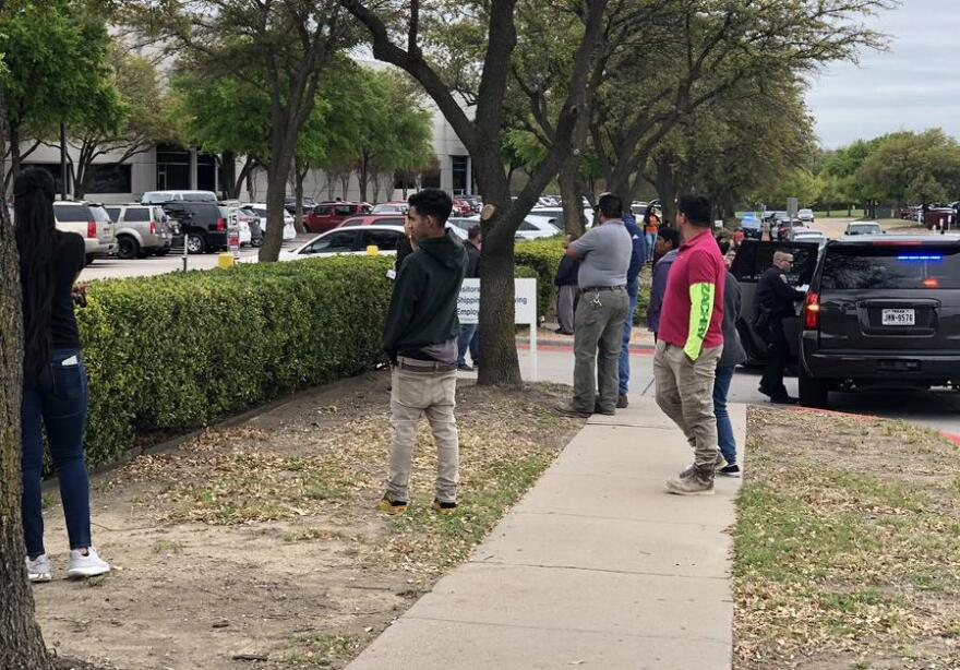 Family of employees inside CVE Technology Group in Allen gathered outside, waiting for word about their relatives during the ICE operation.
