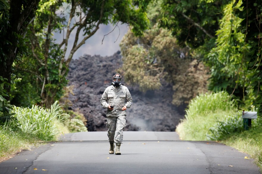 Lt. Col. Charles Anthony of the Hawaii National Guard measures sulfur dioxide gas levels at a lava flow on Highway 137 southeast of Pahoa.