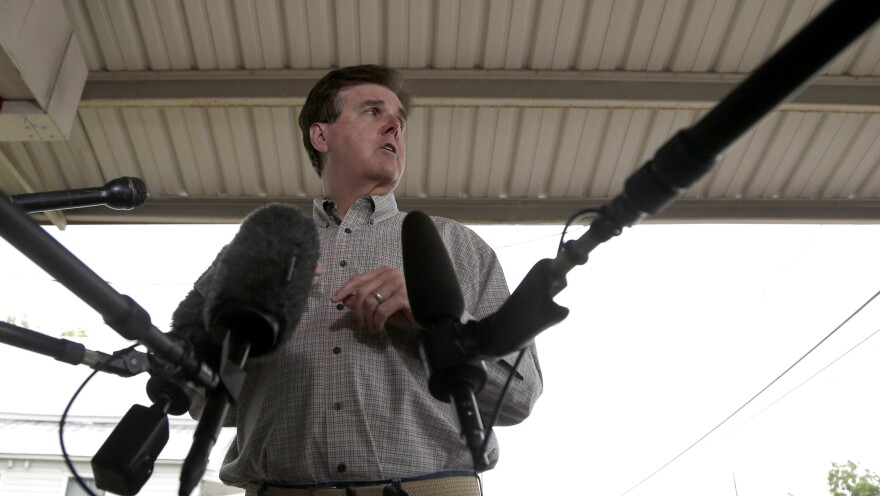 Texas Republican Dan Patrick, who defeated Lt. Gov. David Dewhurst, faces the media at a polling place Tuesday in Houston.