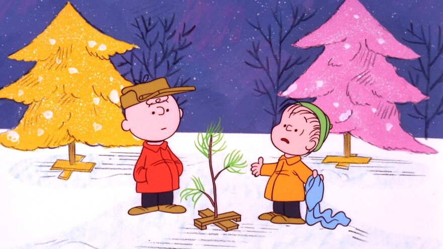 "Charlie Brown and Linus pick out a scrawny tree in <em>A Charlie Brown Christmas</em>, a TV special based on the ""Peanuts"" comic strip by Charles M. Schulz. The beloved show is airing for the 50th year Tuesday."