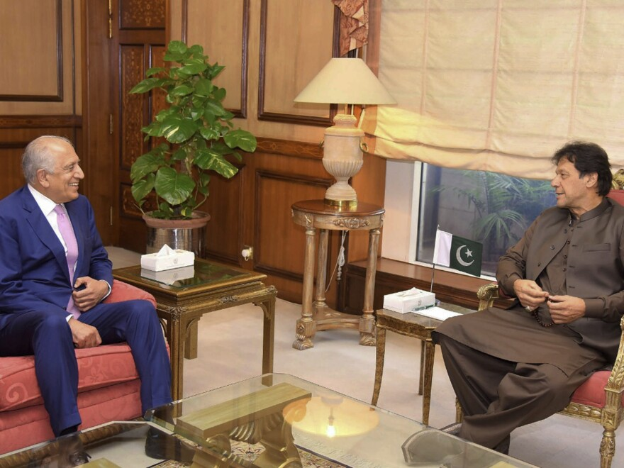 Pakistan's Prime Minister Imran Khan meets U.S. Special Envoy Zalmay Khalilzad (left) in Islamabad on Aug. 1. Khalilzad met Khan ahead of peace talks in Qatar with the Taliban.