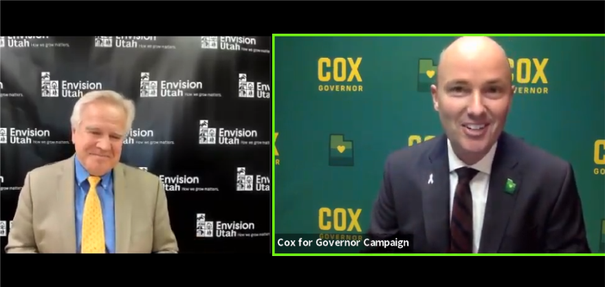 """Photo of a man in a tan suit in front of a banner reading """"Envision Utah"""" and photo of a man wearing a blue suit in front of a banner reading """"Cox Governor"""""""