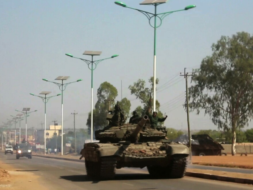 A military tank patrols along one of the main roads in the South Sudanese capital of Juba on Dec. 16, 2013, when a citywide curfew was declared.