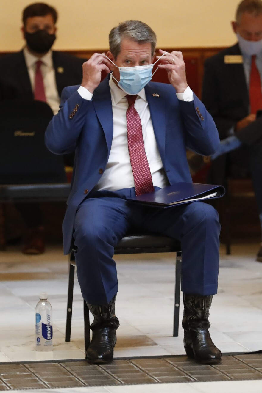 Georgia Gov. Brian Kemp gave a coronavirus briefing at the Capitol Friday, in Atlanta. Kemp has filed a lawsuit against the city over its face-mask requirement.