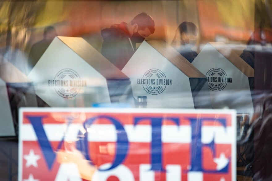 Voters cast ballots at the Arbor Walk Shopping Center in North Austin.