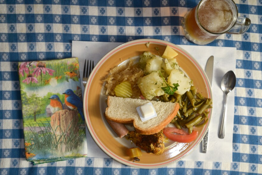 The sampler plate at the Hutte Restaurant included parsley potatoes, sauerkraut, bratwurst, green beans, curried chicken, bread and a chunk of Swiss cheese.