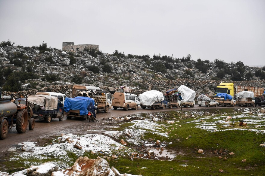 Syrian civilians flee from Idlib, seeking safety from the fighting that began escalating in December.