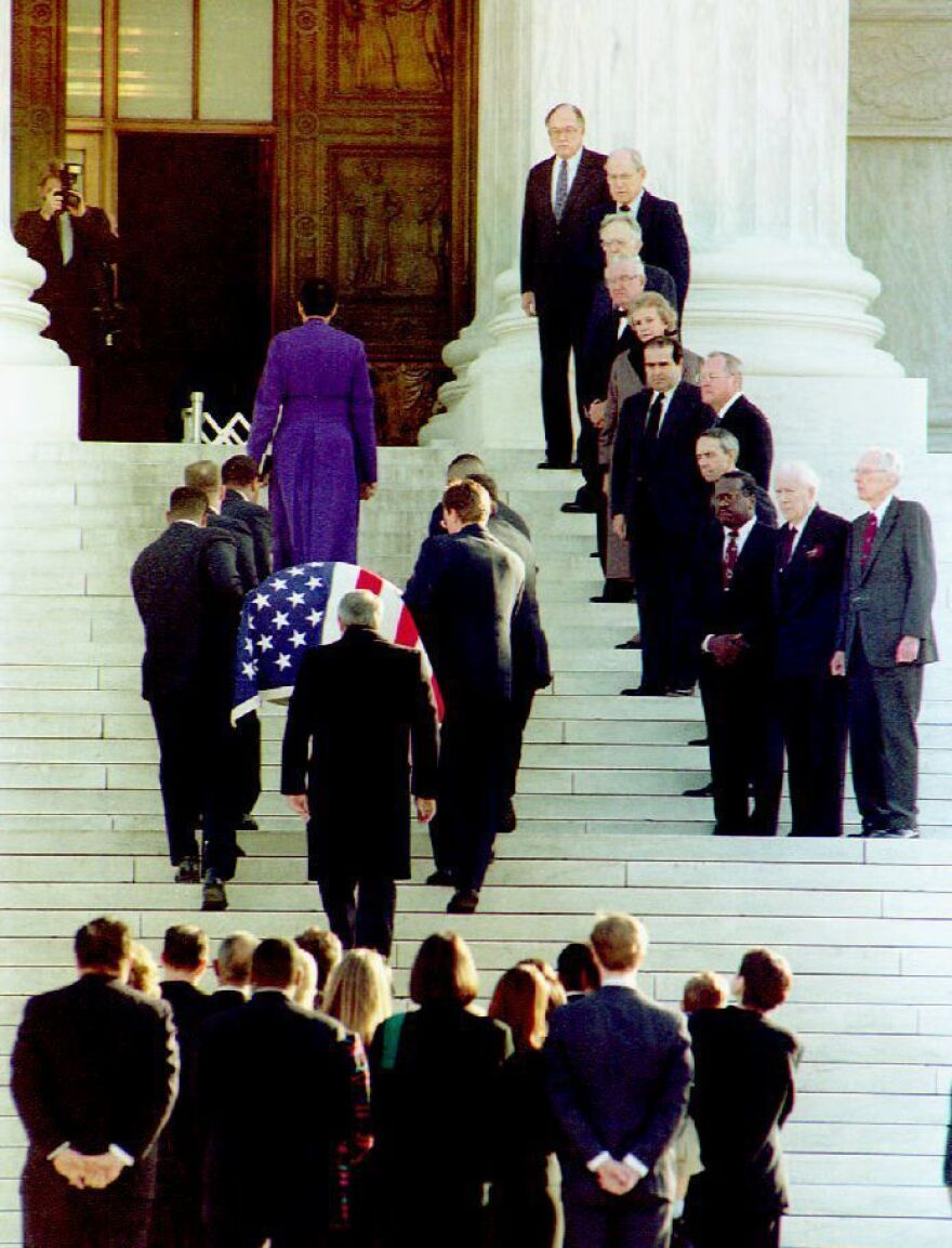 Former Supreme Court Justice Thurgood Marshall's casket is carried up the steps of the U.S. Supreme Court, past the nine current justices and other retired members of the high court in January of 1993.