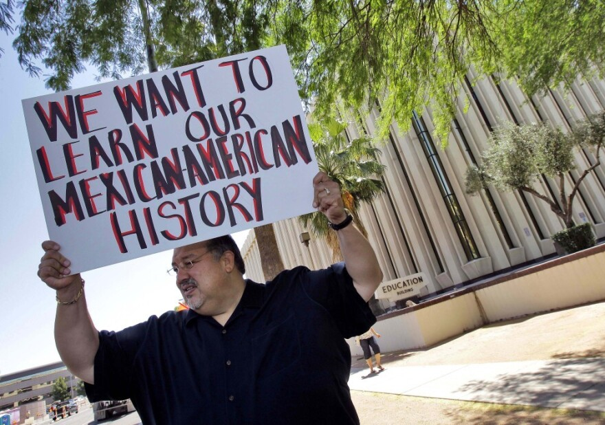 Carlos Galindo protests in support of Tucson's ethnic studies program in May.