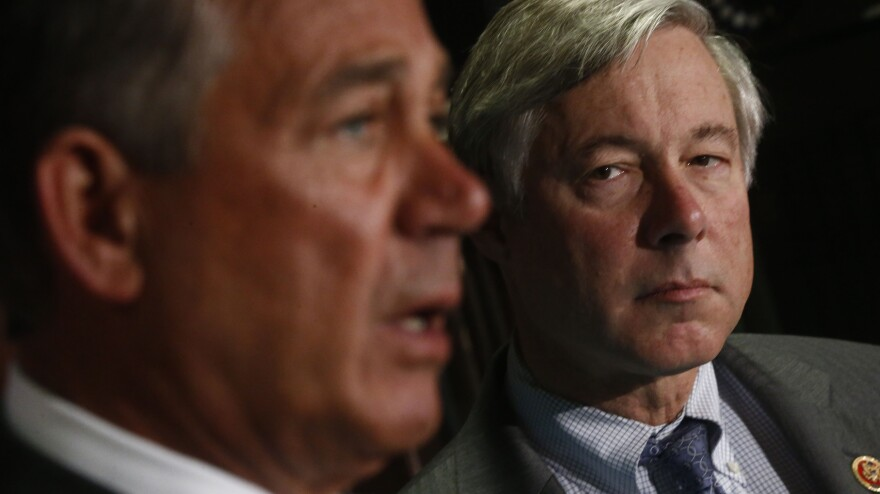 The House votes Friday on a bill submitted by GOP Rep. Fred Upton of Michigan, shown with Speaker John Boehner, that seeks to ensure Americans can keep their existing insurance plans even if those policies don't meet standards in the Affordable Care Act.