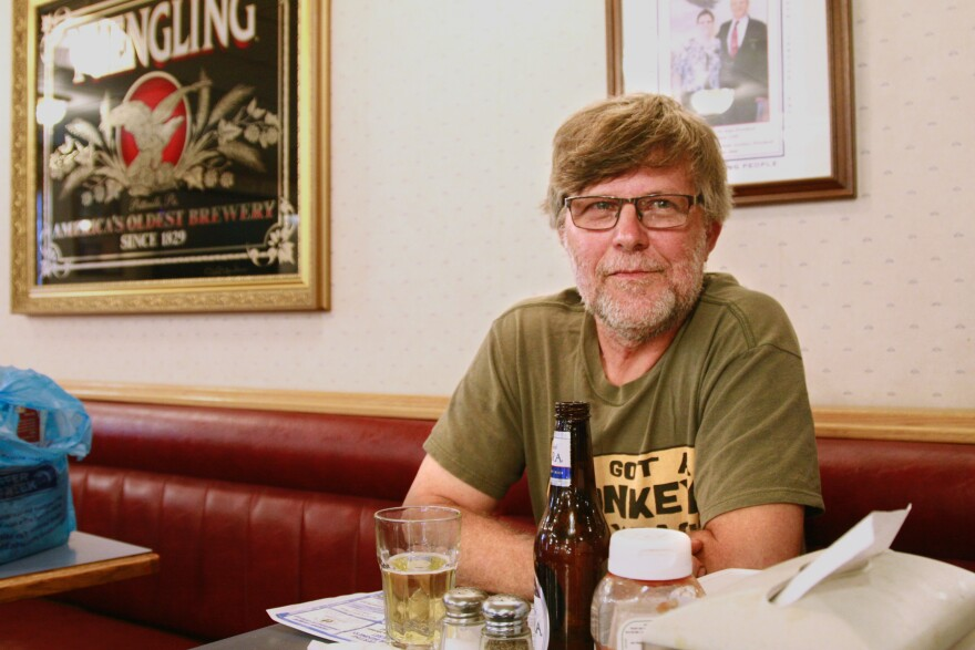 Ernest Shaulis, a coal miner of 33 years, enjoys a beer on burger night at the Fraternal Order of Eagles in Somerset County, Pa.