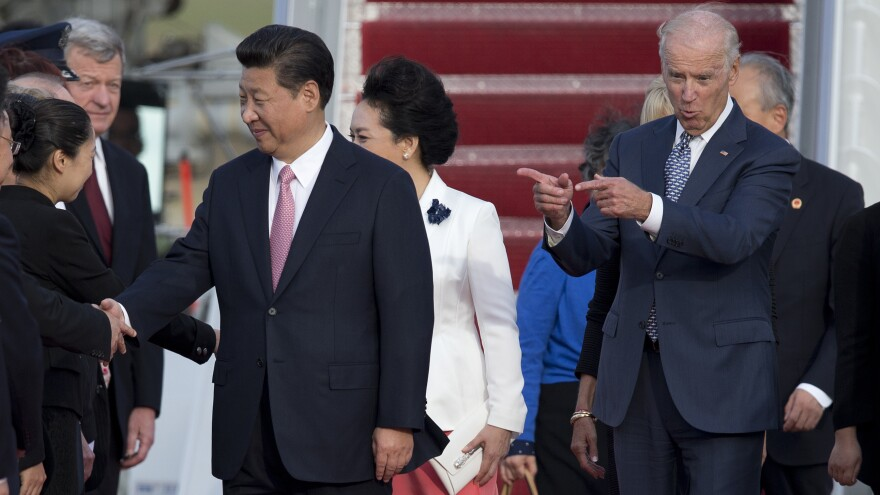 Then-Vice President Joe Biden gestures toward Chinese President Xi Jinping and his wife Peng Liyuan during an arrival ceremony in Andrews Air Force Base, Md., Thursday, Sept. 24, 2015.