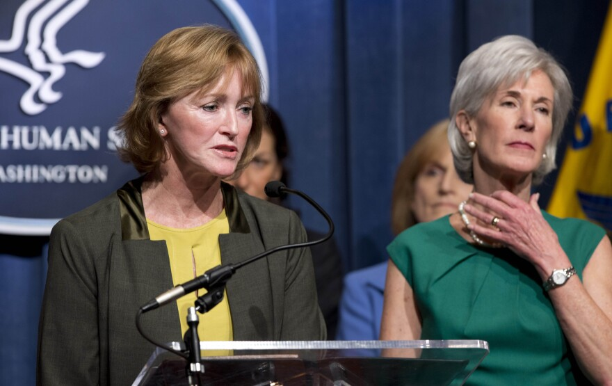 """Health and Human Services Secretary Kathleen Sebelius, (who we're sure was not intentionally making the """"choke"""" sign) and Marilyn Tavenner, head of the HHS agency that oversaw the Obamacare website project."""