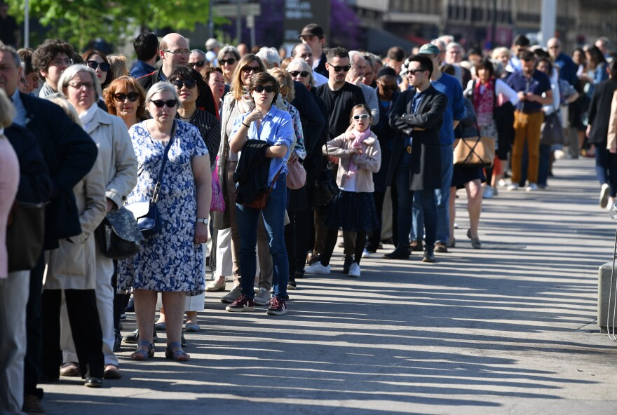 Worshippers queue to attend the Notre Dame Easter Mass at the church of St. Eustache in Paris. Notre Dame's Easter service was held at the nearby church following the fire that caused extensive damage to the historic landmark.
