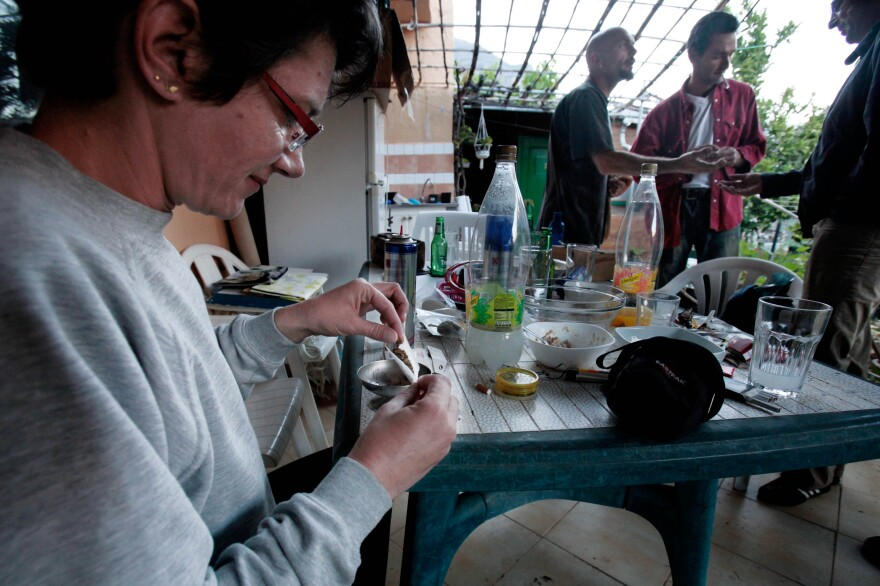 Eliane Detraz, a 42-year-old Swiss national member of the Sibaratas Med Can club, rolls a joint at the plantation of the association in Spain's Canary Islands in April 2013.