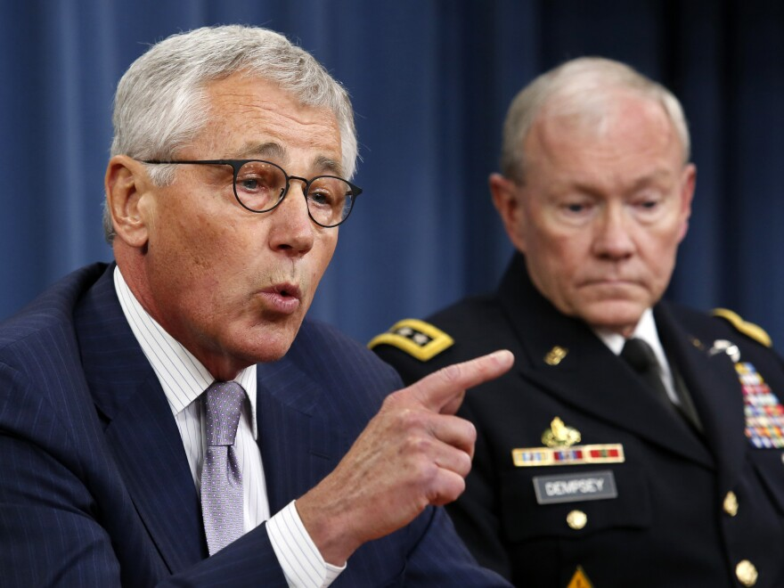 """Secretary of Defense Chuck Hagel (left) and Chairman of the Joint Chiefs of Staff Gen. Martin Dempsey during a Pentagon briefing on Thursday. Hagel said Islamic State militants in Iraq and Syria posed a threat """"beyond anything we've seen."""""""