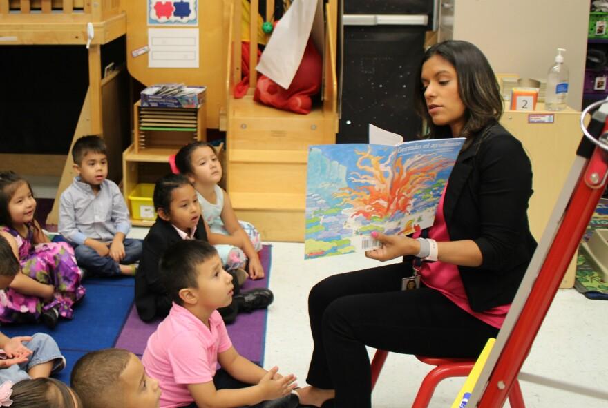 Dual language teacher Joann Chambers reads to her preschool class on May 23, 2019.