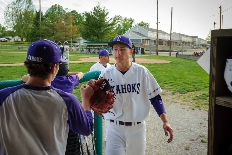 Collinsville High School pitcher Ryan Siverly is welcomed into the dugout during the Kahoks' baseball game against O'Fallon on Tuesday, April 25, 2017.
