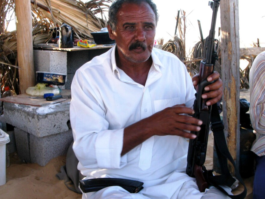 <p> Fayez Eid, 61, says he and five other Bedouins guard the al-Midan station. He says the company turned down the Egyptian military's offer to guard the 14 stations for nearly $2 million a year.</p>