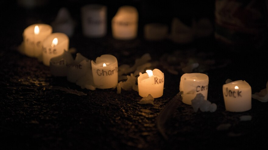 Candles with the names of victims of the Sandy Hook Elementary School shooting, at a makeshift memorial near the entrance to the grounds of Sandy Hook Elementary School.