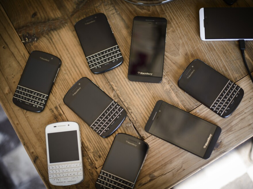 "BlackBerry smartphones on a table during a ""BlackBerry Brunch"" in June in Berlin."