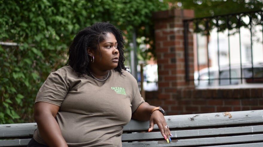 Shakira Franklin sits in a lot near her home, where she often takes breaks from her nearby job. Franklin is working to build a splash park in the lot for neighborhood residents to cool off in the summer heat.