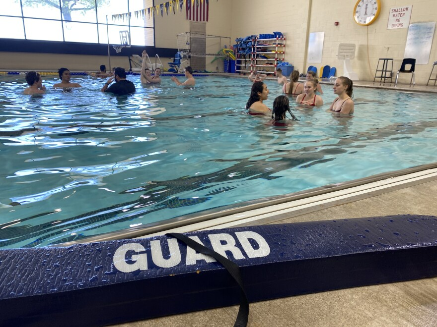 About a dozen teenagers and young adults attended a recent lifeguard certification class at Northwest High School. Because of COVID-related closures last year, some pools are having a hard time finding enough lifeguards.